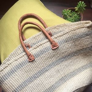woven beach bag with genuine leather straps